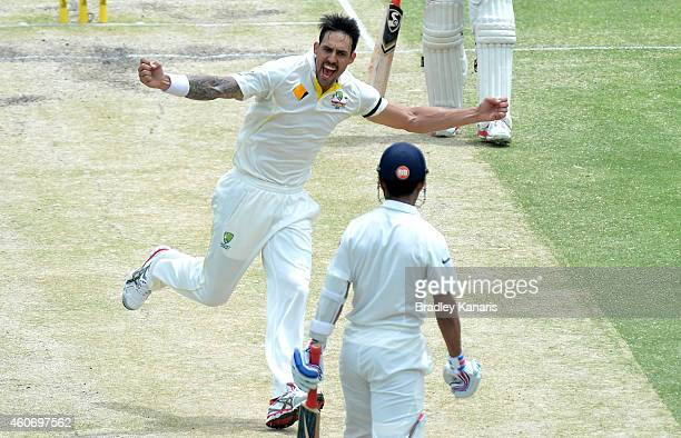 Mitchell Johnson of Australia celebrates taking the wicket of Ajinkya Rahane of India during day four of the 2nd Test match between Australia and...