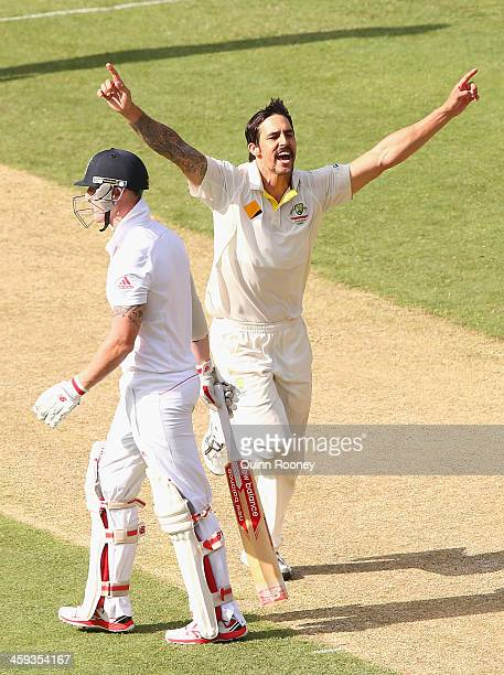 Mitchell Johnson of Australia celebrates taking the wicket of Ben Stokes of England during day one of the Fourth Ashes Test Match between Australia...