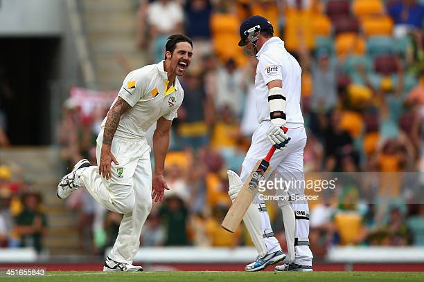 Mitchell Johnson of Australia celebrates taking the wicket of Graeme Swann of England during day four of the First Ashes Test match between Australia...