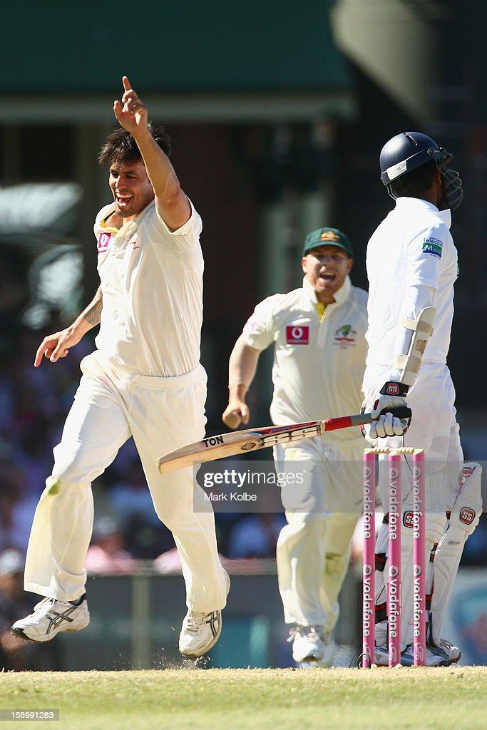 Mitchell Johnson of Australia celebrates taking the wicket of Lahiru Thirimanne of Sri Lanka during day three of the Third Test match between Australia and Sri Lanka at Sydney Cricket Ground on January 5, 2013 in Sydney, Australia.