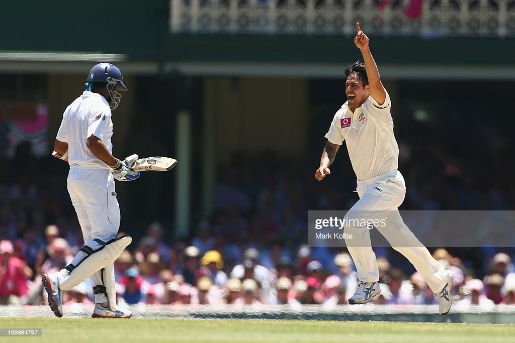 Mitchell Johnson of Australia celebrates taking the wicket of Tillakaratne Dilshan of Sri Lanka during day three of the Third Test match between Australia and Sri Lanka at Sydney Cricket Ground on January 5, 2013 in Sydney, Australia.