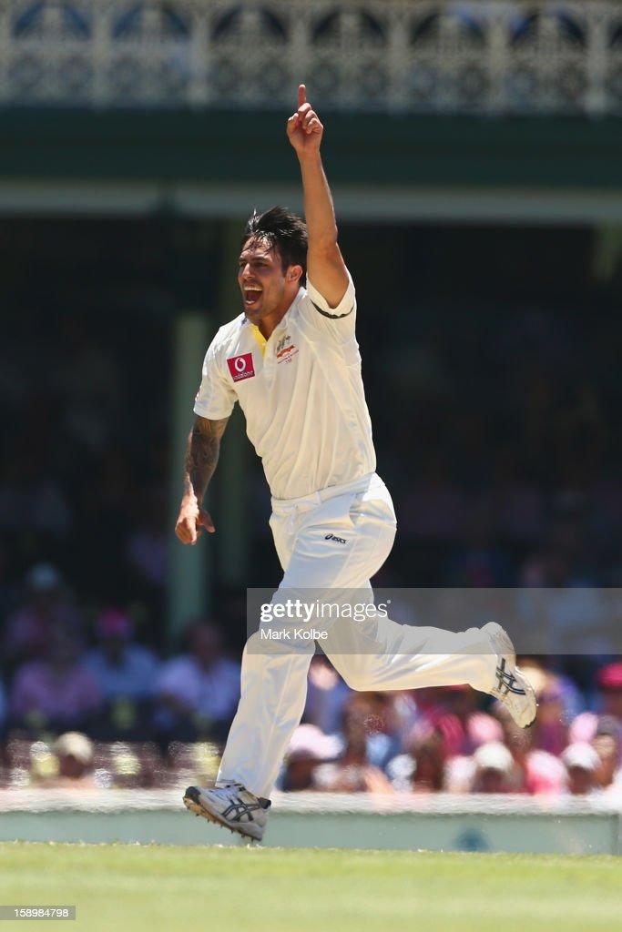 Mitchell Johnson of Australia celebrates taking the wicket of Tillakaratne Dilshan of Sri Lanka during day three of the Third Test match between Australia and Sri Lanka at Sydney Cricket Ground on January 5, 2013 in Sydney, Australia.