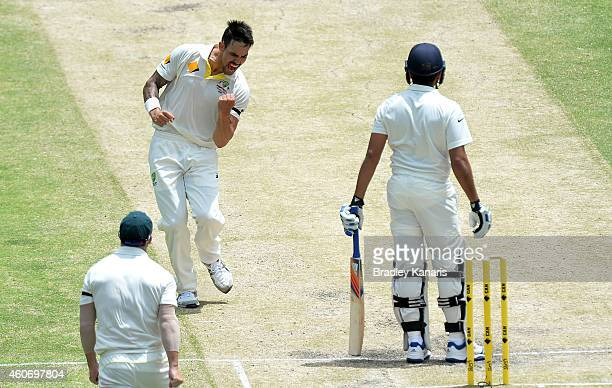 Mitchell Johnson of Australia celebrates taking the wicket of Rohit Sharma of India during day four of the 2nd Test match between Australia and India...