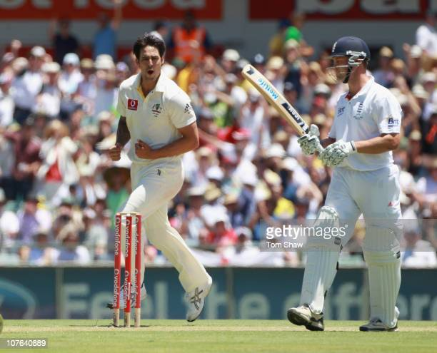 Mitchell Johnson of Australia celebrates taking the wicket of Jonathan Trott of England during day two of the Third Ashes Test match between...