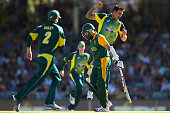 Mitchell Johnson of Australia celebrates the dismissal of Hashim Amla of South Africa during the One Day International match between Australia and...