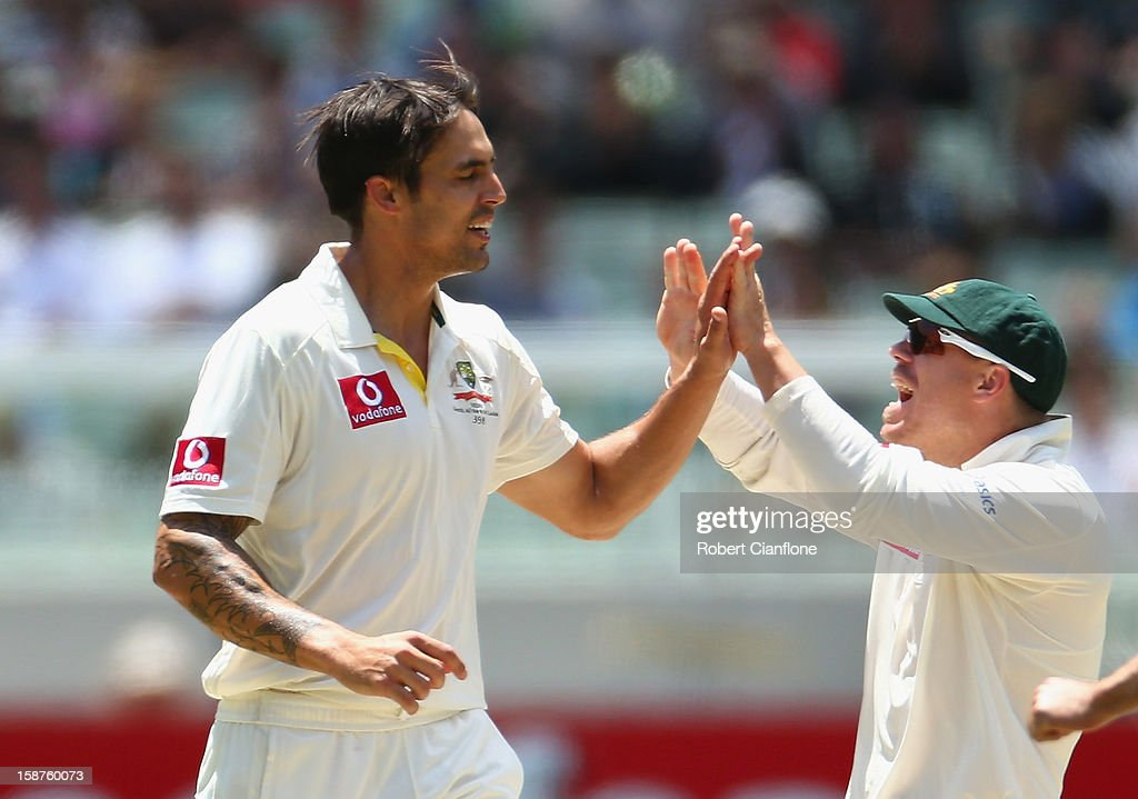 Mitchell Johnson of Australia celebrates the wicket of Angelo Mathews of Sri Lanka with David Warner during day three of the Second Test match between Australia and Sri Lanka at Melbourne Cricket Ground on December 28, 2012 in Melbourne, Australia.
