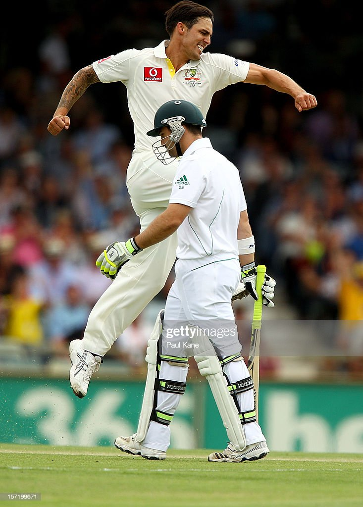Mitchell Johnson of Australia celebrates the wicket of Dean Elgar of South Africa during day one of the Third Test Match between Australia and South Africa at WACA on November 30, 2012 in Perth, Australia.