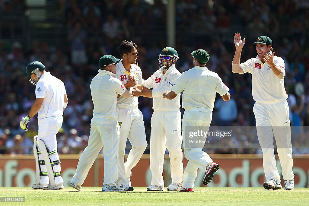 Mitchell Johnson of Australia celebrates the wicket of Dean Elgar of South Africa with team mates during day three of the Third Test Match between Australia and South Africa at WACA on December 2, 2012 in Perth, Australia.