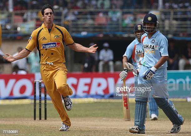 Mitchell Johnson of Australia celebrates the wicket of Gautam Gambhir of India during the second one day international match between India and...