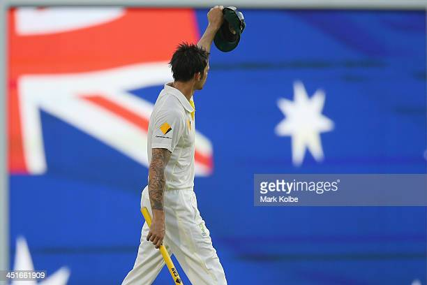 Mitchell Johnson of Australia celebrates victory after he took the wicket of James Anderson of England to finish the test during day four of the...
