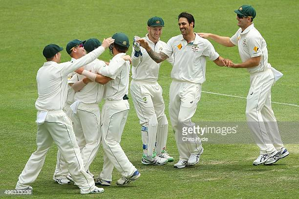 Mitchell Johnson of Australia celebrates with team mates after dismissing James Neesham of New Zealand during day five of the First Test match...