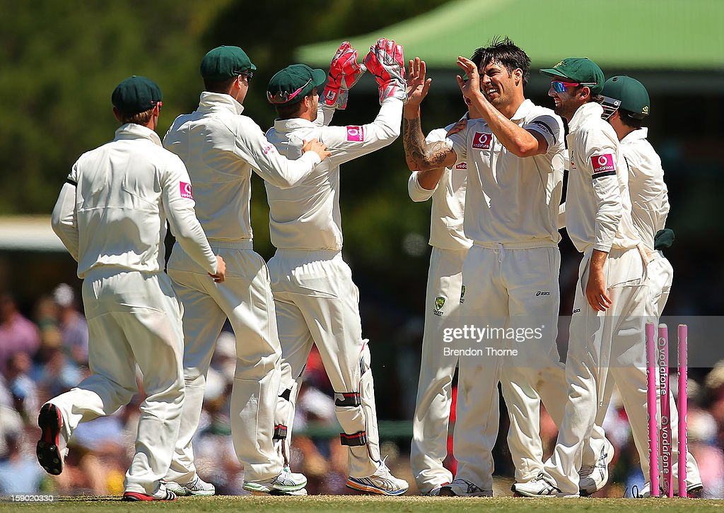 Mitchell Johnson of Australia celebrates with team mates after claiming the wicket Suranga Lakmal of Sri Lanka during day four of the Third Test match between Australia and Sri Lanka at the Sydney Cricket Ground on January 6, 2013 in Sydney, Australia.