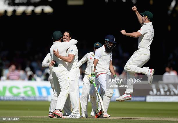 Mitchell Johnson of Australia celebrates with teammates after dismissing Moeen Ali of England during day four of the 2nd Investec Ashes Test match...