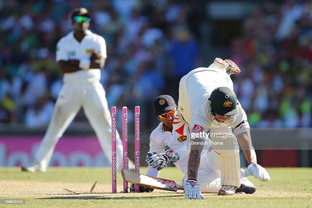 Mitchell Johnson of Australia collides with <a gi-track='captionPersonalityLinkClicked' href=/galleries/search?phrase=Dinesh+Chandimal&family=editorial&specificpeople=4884949 ng-click='$event.stopPropagation()'>Dinesh Chandimal</a> of Sri Lanka during day two of the Third Test match between Australia and Sri Lanka at Sydney Cricket Ground on January 4, 2013 in Sydney, Australia.