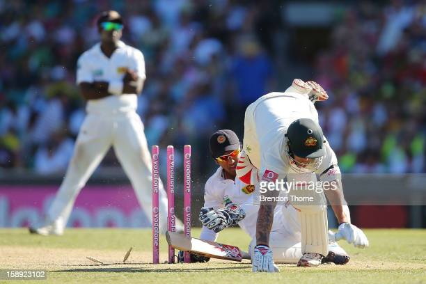 Mitchell Johnson of Australia collides with Dinesh Chandimal of Sri Lanka during day two of the Third Test match between Australia and Sri Lanka at...
