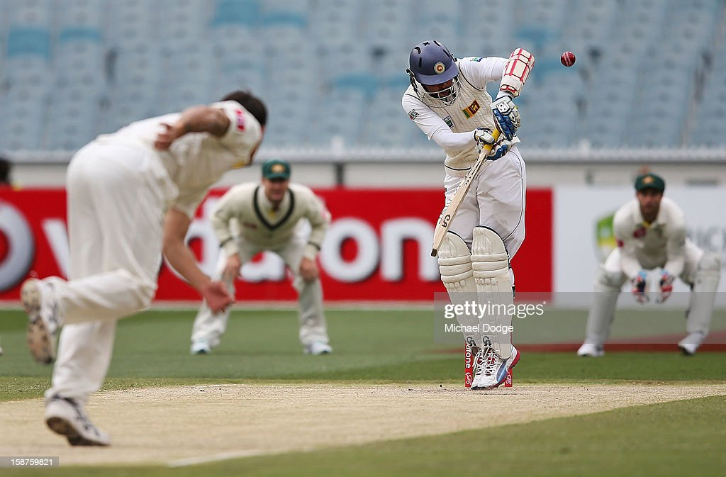 Mitchell Johnson of Australia dismisses Tillakaratne Dilshan of Sri Lanka who was caught by Ed Cowan during day three of the Second Test match between Australia and Sri Lanka at Melbourne Cricket Ground on December 28, 2012 in Melbourne, Australia.