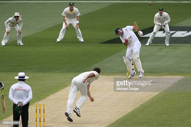 Mitchell Johnson of Australia dismisses Tim Bresnan of England during day two of the Fourth Ashes Test Match between Australia and England at...