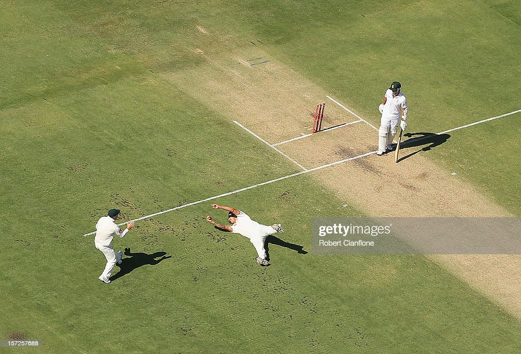 Mitchell Johnson of Australia dives to take the catch of <a gi-track='captionPersonalityLinkClicked' href=/galleries/search?phrase=Alviro+Petersen&family=editorial&specificpeople=4969996 ng-click='$event.stopPropagation()'>Alviro Petersen</a> of South Africa during day two of the Third Test Match between Australia and South Africa at WACA on December 1, 2012 in Perth, Australia.