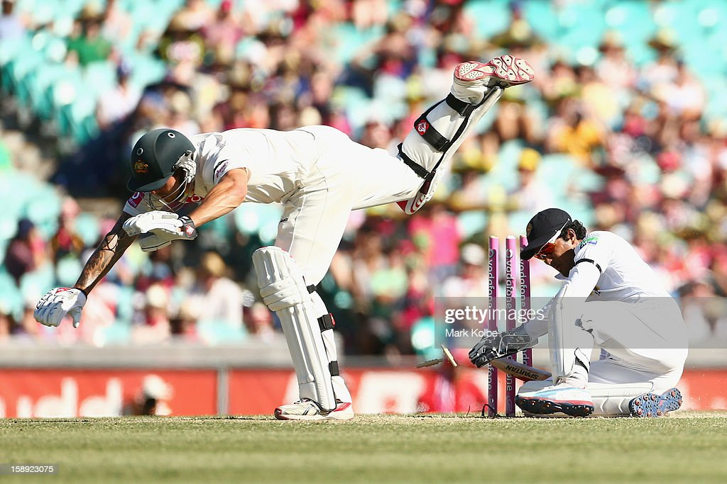 Mitchell Johnson of Australia falls after colliding with Dinesh Chandimal of Sri Lanka during day two of the Third Test match between Australia and Sri Lanka at Sydney Cricket Ground on January 4, 2013 in Sydney, Australia.