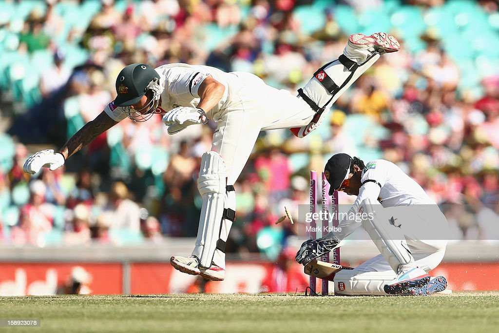 Mitchell Johnson of Australia falls after colliding with <a gi-track='captionPersonalityLinkClicked' href=/galleries/search?phrase=Dinesh+Chandimal&family=editorial&specificpeople=4884949 ng-click='$event.stopPropagation()'>Dinesh Chandimal</a> of Sri Lanka during day two of the Third Test match between Australia and Sri Lanka at Sydney Cricket Ground on January 4, 2013 in Sydney, Australia.