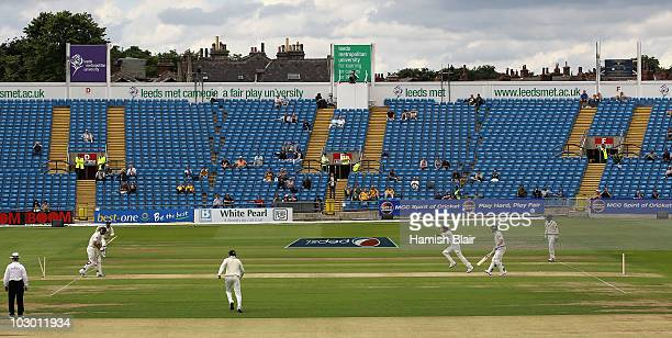 Mitchell Johnson of Australia is bowled by Mohammad Aamer of Pakistan in front of a sparse crowd on the Western Terrace during day one of the 2nd...
