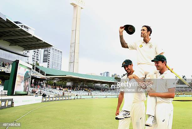 Mitchell Johnson of Australia is chaired off by Mitchell Starc and Josh Hazlewood of Australia after his final test match during day five of the...