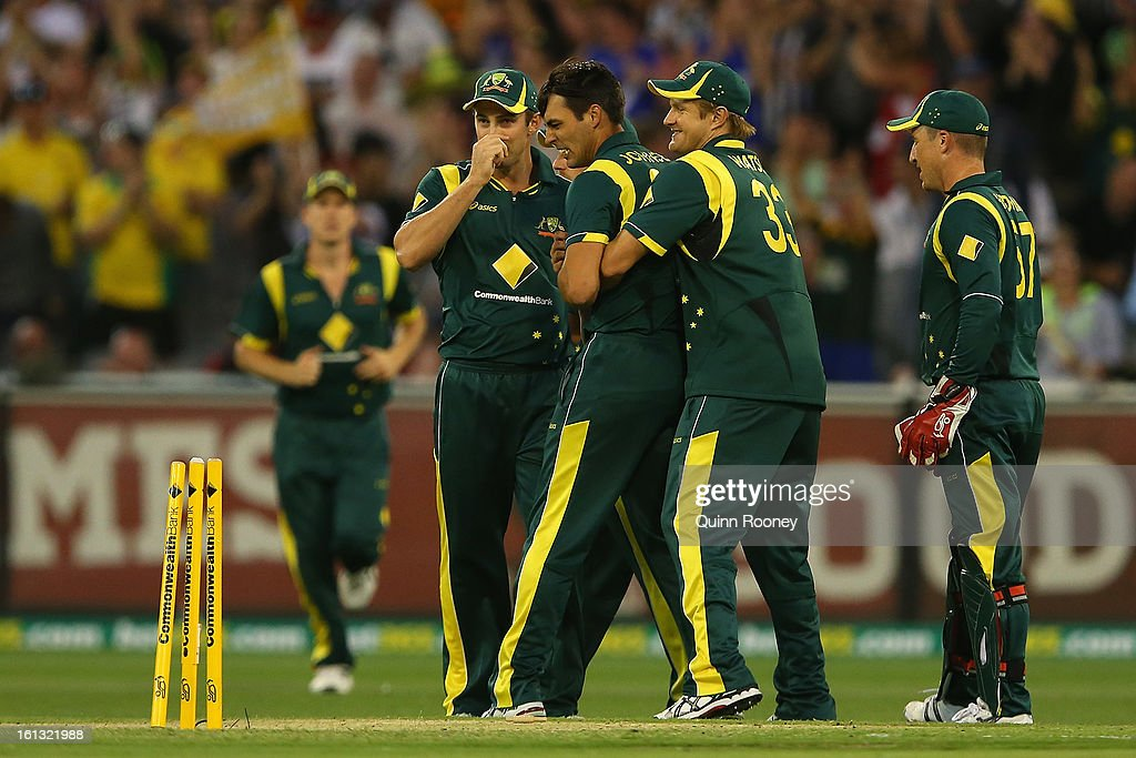 Mitchell Johnson of Australia is congratulated by team mates after getting the wicket of Dwayne Bravo of the West Indies during game five of the Commonwealth Bank International Series between Australia and the West Indies at Melbourne Cricket Ground on February 10, 2013 in Melbourne, Australia.
