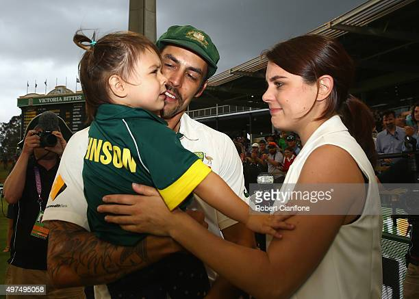 Mitchell Johnson of Australia is greeted by his wife Jessica and daughter Rubika after day five of the second Test match between Australia and New...