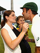 Mitchell Johnson of Australia is greeted by his wife Jessica and daughter Rubika after his final test match during day five of the second Test match...