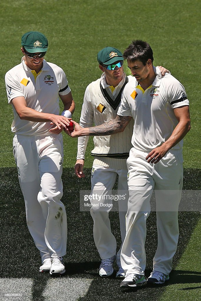 <a gi-track='captionPersonalityLinkClicked' href=/galleries/search?phrase=Mitchell+Johnson+-+Cricket+Player&family=editorial&specificpeople=665783 ng-click='$event.stopPropagation()'>Mitchell Johnson</a> of Australia is supported by <a gi-track='captionPersonalityLinkClicked' href=/galleries/search?phrase=Peter+Siddle&family=editorial&specificpeople=2104718 ng-click='$event.stopPropagation()'>Peter Siddle</a> (L) and <a gi-track='captionPersonalityLinkClicked' href=/galleries/search?phrase=Michael+Clarke+-+Cricket+Player&family=editorial&specificpeople=175853 ng-click='$event.stopPropagation()'>Michael Clarke</a> after he hit Virat Kohli of India on the helmet with a bouncer during day three of the First Test match between Australia and India at Adelaide Oval on December 11, 2014 in Adelaide, Australia.