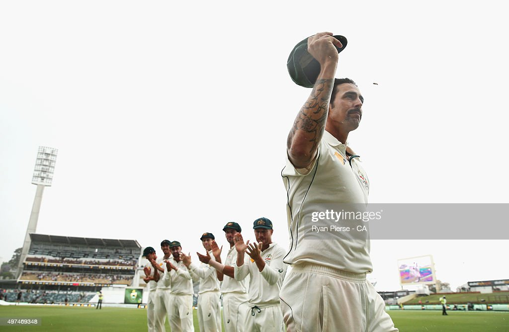 Mitchell Johnson of Australia leaves the ground during a rain delay in his final test match during day five of the second Test match between...