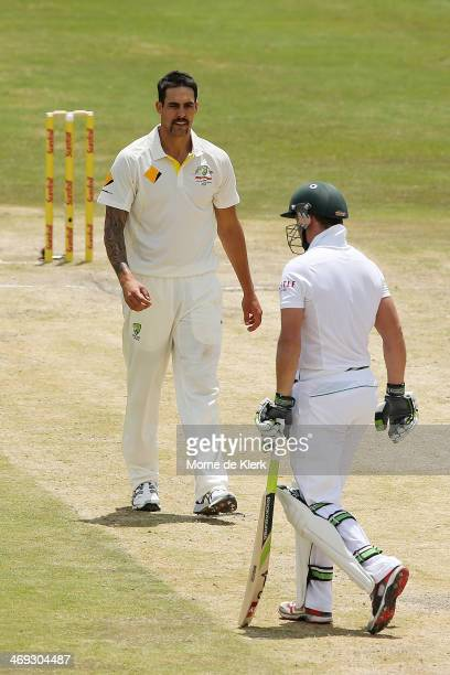 Mitchell Johnson of Australia looks at AB De Villiers of South Africa after getting him out during day three of the First Test match between South...