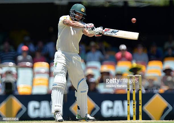 Mitchell Johnson of Australia plays a shot during day three of the 2nd Test match between Australia and India at The Gabba on December 19 2014 in...