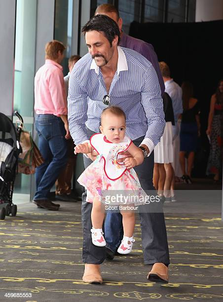 Mitchell Johnson of Australia plays with his daughter Rubika ahead of the Cricket Australia Christmas Day Lunch at Crown Metropol on December 25 2013...