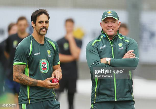 Mitchell Johnson of Australia prepares to bowl as bowling coach Craig McDermott looks on during an Australian Ashes training session at the Melbourne...