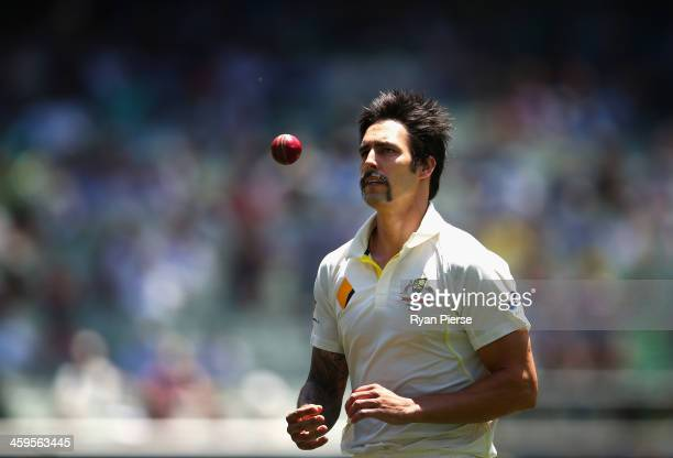 Mitchell Johnson of Australia prepares to bowl during day three of the Fourth Ashes Test Match between Australia and England at Melbourne Cricket...