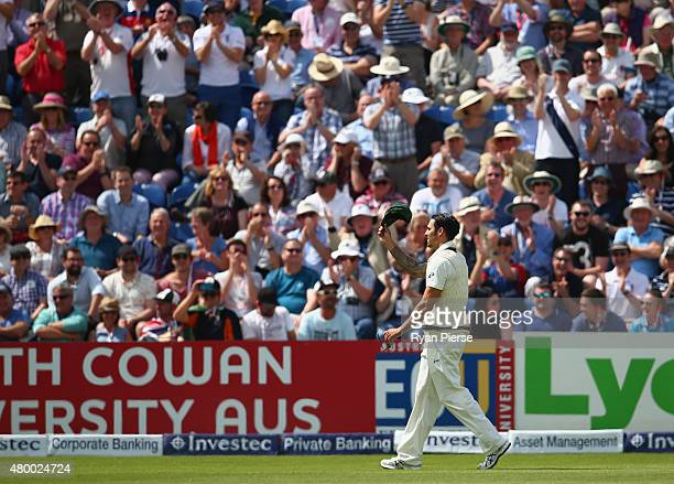 Mitchell Johnson of Australia raises his cap to the crowd after he reached 100 runs against his bowling during day two of the 1st Investec Ashes Test...