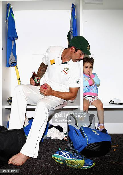 Mitchell Johnson of Australia relaxes in the change rooms with his daughter Rubika after his last test match during day five of the second Test match...