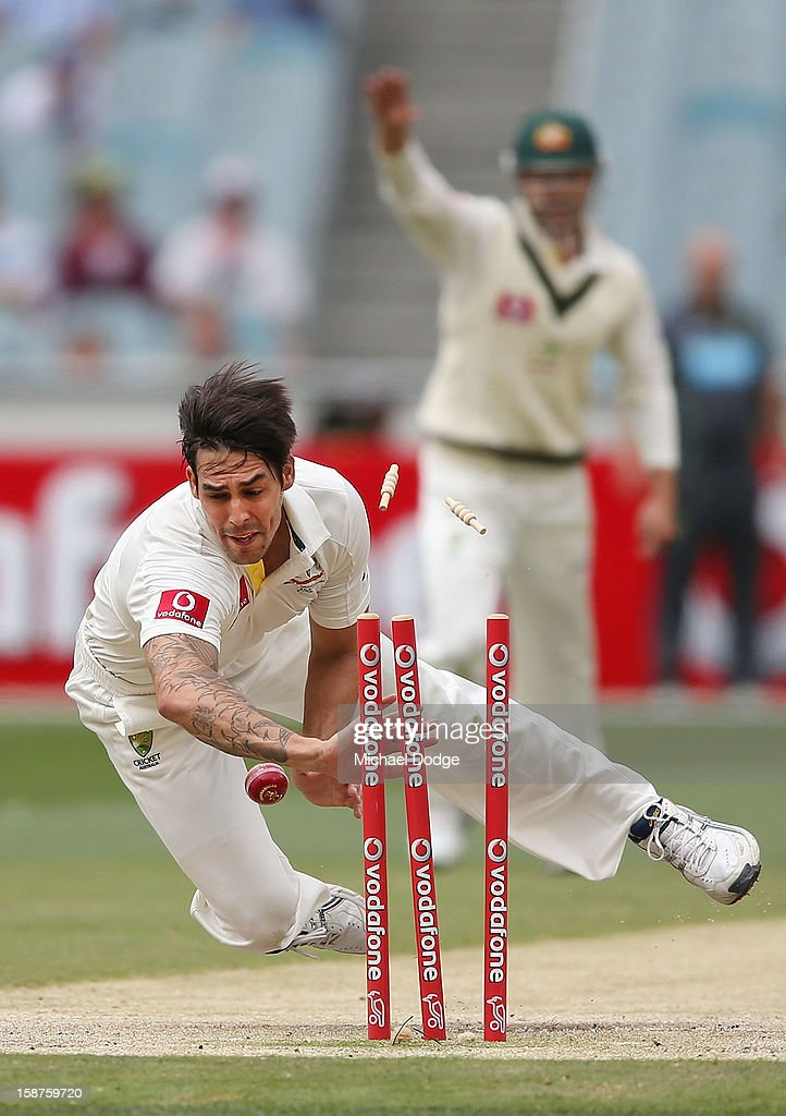 Mitchell Johnson of Australia runs out <a gi-track='captionPersonalityLinkClicked' href=/galleries/search?phrase=Dimuth+Karunaratne&family=editorial&specificpeople=7915648 ng-click='$event.stopPropagation()'>Dimuth Karunaratne</a> during day three of the Second Test match between Australia and Sri Lanka at Melbourne Cricket Ground on December 28, 2012 in Melbourne, Australia.