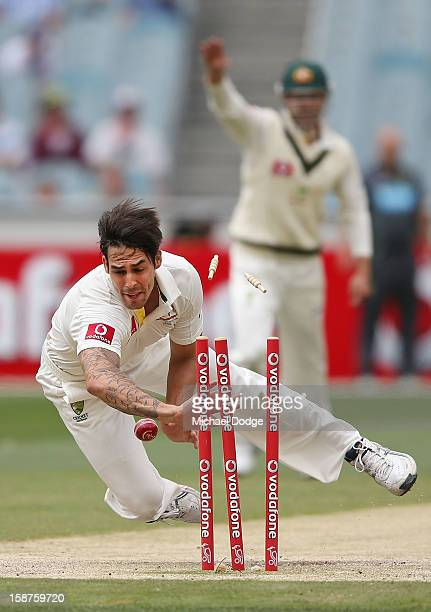 Mitchell Johnson of Australia runs out Dimuth Karunaratne during day three of the Second Test match between Australia and Sri Lanka at Melbourne...