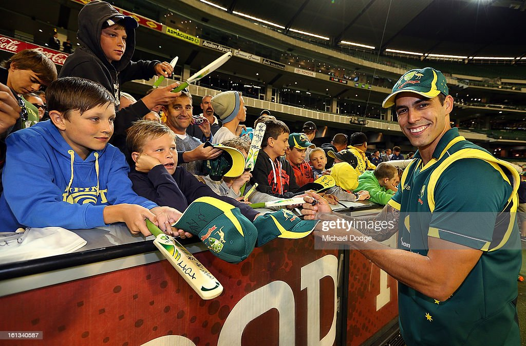 Mitchell Johnson of Australia signs autographs for cricket fans after his win in game five of the Commonwealth Bank International Series between Australia and the West Indies at Melbourne Cricket Ground on February 10, 2013 in Melbourne, Australia.