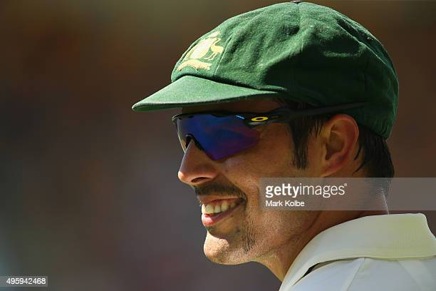 Mitchell Johnson of Australia smiles as he listens to the crowd during day two of the First Test match between Australia and New Zealand at The Gabba...