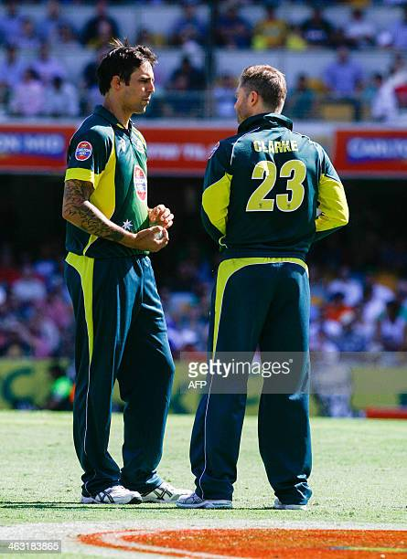 Mitchell Johnson of Australia speaks to captain Michael Clarke during the second oneday international cricket match between Australia and England at...