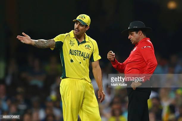 Mitchell Johnson of Australia speaks to umpire Aleem Dar during the 2015 ICC Cricket World Cup match between Australia and Sri Lanka at Sydney...
