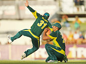 Mitchell Johnson of Australia takes a catch to dismiss Vernon Philander of South Africa as David Warner attempts to catch the ball as well during the...