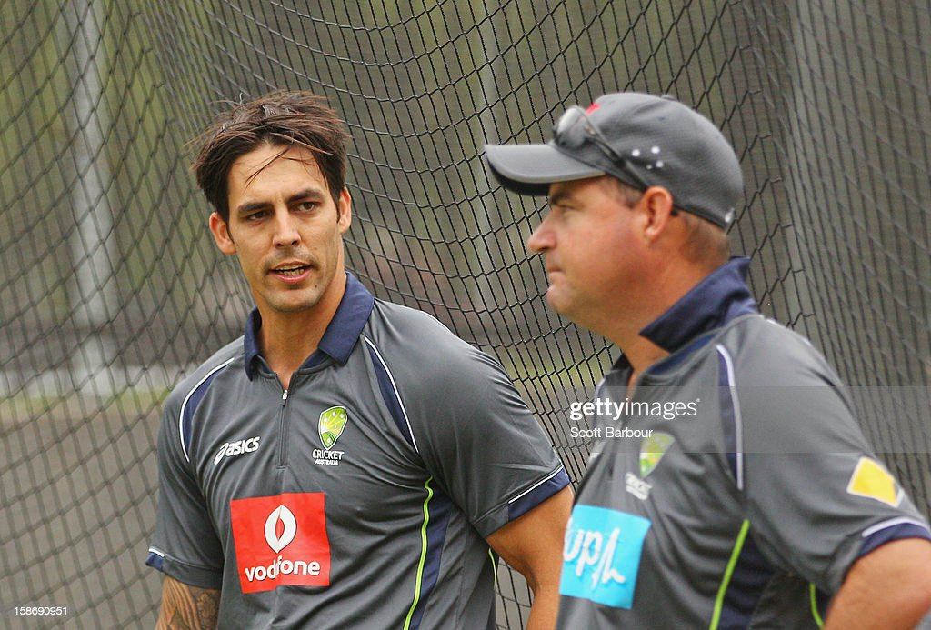 Mitchell Johnson of Australia talks with Australian coach <a gi-track='captionPersonalityLinkClicked' href=/galleries/search?phrase=Mickey+Arthur&family=editorial&specificpeople=789398 ng-click='$event.stopPropagation()'>Mickey Arthur</a> during an Australian training session at the Melbourne Cricket Ground on December 24, 2012 in Melbourne, Australia.