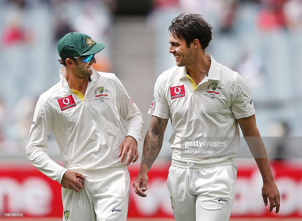 Mitchell Johnson of Australia (R) talks with Nathan Lyon after a wicket during day three of the Second Test match between Australia and Sri Lanka at Melbourne Cricket Ground on December 28, 2012 in Melbourne, Australia.