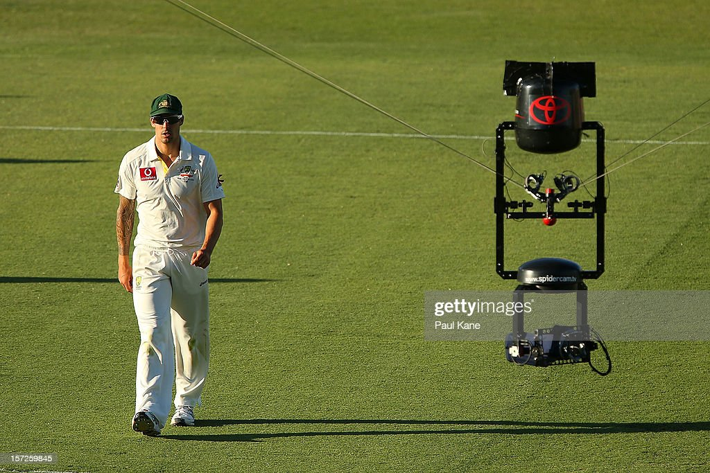 Mitchell Johnson of Australia walks back to his fielding position as Spider Cam follows during day two of the Third Test Match between Australia and...