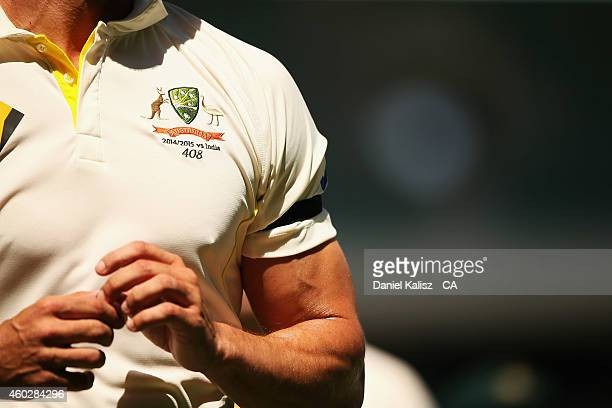Mitchell Johnson of Australia wears a black armband and Test Cap number '408' in a tribute to the late Phillip Hughes during day three of the First...