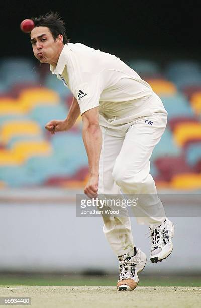 Mitchell Johnson of the Bulls bowls during day one of the Pura Cup match between the Queensland Bulls and Tasmanian Tigers at the Gabba on October 17...